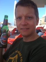 Michael having a beer on the beach in Tel Aviv